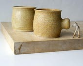 Two tulip shaped mugs - hand thrown stoneware glazed in natural brown