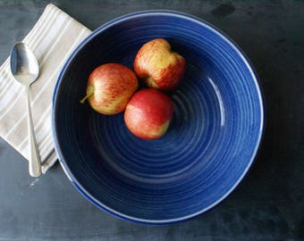 One wide pottery serving bowl - glazed in glossy ocean blue