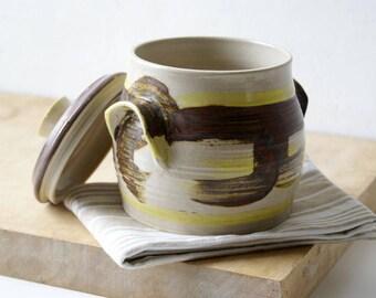 Lidded barrel shaped kitchen canister - slipware decorated pottery jar