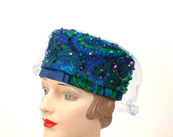 1960s hat pillbox blue green paisley beaded studs woven fabric hat with veil by Lecie Size 21