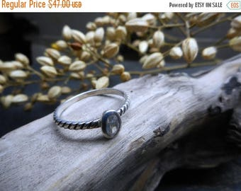 Breena.  Feminine Twisted Sterling Silver & white sapphire dainty engagement or promise ring