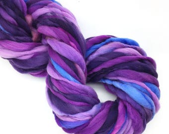 Handspun beyond super bulky yarn, 43 yards and 2.9 ounces/ 92 grams of thick and thin in hand dyed merino wool