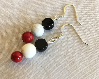 Onyx, marbled, and red earrings