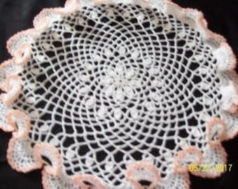 Set of two (2) round white doilies trimmed in Peach