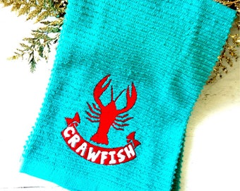 Turquoise cajun crawfish embroidered towel.
