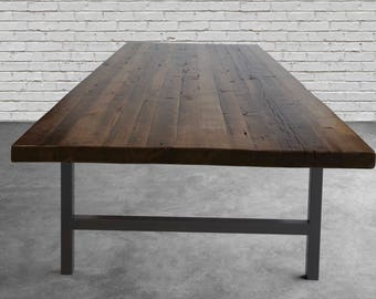 """Conference Table made with 2.5"""" thick reclaimed wood top and steel base.  Variety of table bases, sizes and finishes available."""