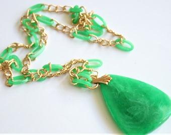 Vintage green plastic necklace. 1960s pendant