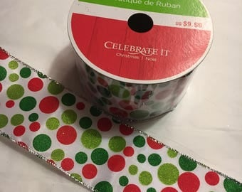 White ribbon with red green and lime polka dots 2.5 inches wide, each roll is 25 ft. long