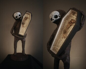 """Midget sculpture """"Reed"""" with his mummified friend"""
