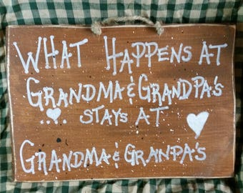 What Happens at Grandma and Grandpa's  Wood sign 9 x 13 inches