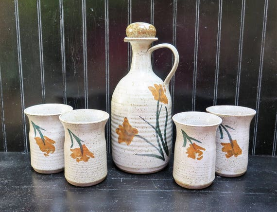 Pottery Decanter and 4 Tumbler set Vintage Hand made pottery white speckled flower design