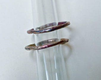 Two thin rings in copper and silver fused clumps.