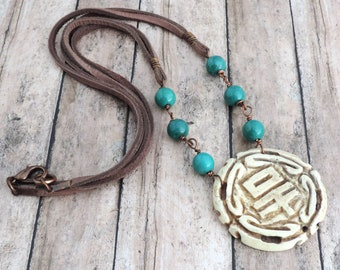 Carved Bone Medallion Boho Necklace with Turquoise Beads and Brown Deerskin Leather Cord - Boho Statement Jewelry