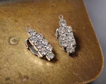 Pair of settings part of Vintage clip on earrings, silver tone metal with glass rhinestones