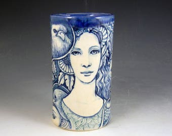 Story vase ceramic blue and white with ladies faces, frog, birds mysterious beast and more