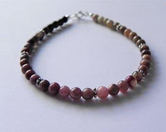 Multi-coloured tourmaline and sterling silver gemstone bracelet.