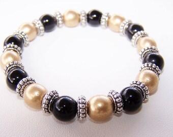 Black gold and silver beaded elastic bracelet
