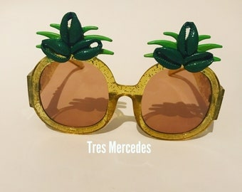 Pineapple sunglasses with cowrie shells