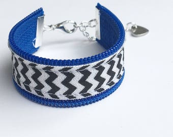thin blue line bracelet. support police officers, police officers wife, leow. blue zipper accent on black and white chevron.