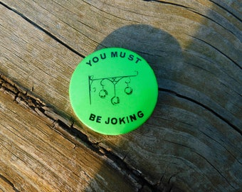 "Vintage 1980's  Neon  Pin Pinback Button That Reads ""You Must Be Joking  "" DR16"