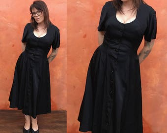 Vintage 1950s Black Swing Dress.  retro rockabilly pinup dress. Fit and flare dress. pockets. lucy dress