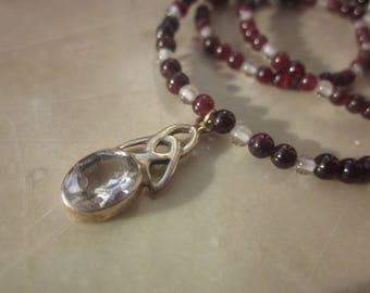 white Topaz Garnet Triquetra Necklace