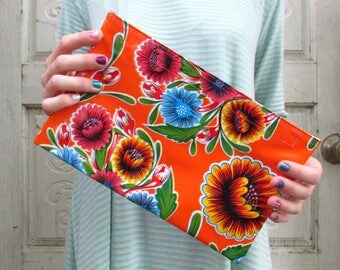 "Orange Floral Oilcloth Clutch Bag, for a purse or makeup bag, regular size, 10.5"" by 6.25"""