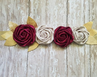 Red and champagne rosettes with gold velvet leaves