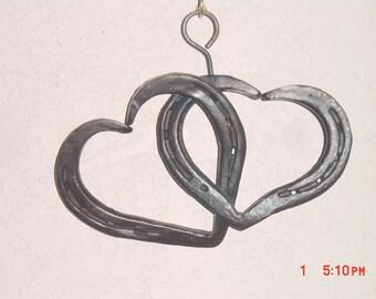 Hand forged horseshoe hearts.   home decor,