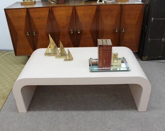 Mid Century Modern pink laminate coffee table cascade shape