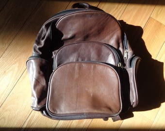 Vintage Dark Brown Full Grain Cowhide Leather Expandable  Backpack with many zippered compartments in Very Good Vintage Condition