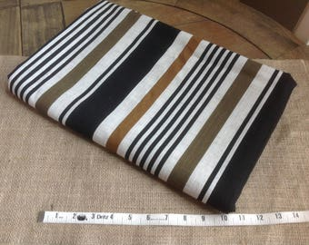Pretty Striped Cotton Fabric with a Natural linen Look and Feel. Black, burnt orange brown and Khaki stripes on beige background