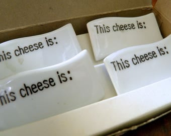 """Set of 4 New-in-Box 1970s Alfred E. Knobler Porcelain """"This Cheese is ..."""" Markers--2-3/8"""" Long x 1-3/4"""" High--Made in Moonachie, N.J."""