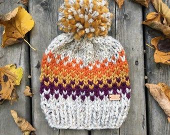 the Sherwoods hat - heather oatmeal chunky knit hat with purple, mustard and orange fair-isle pattern and jumbo pompom