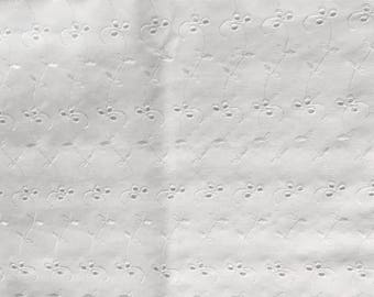 Vintage white eyelet cotton fabric.