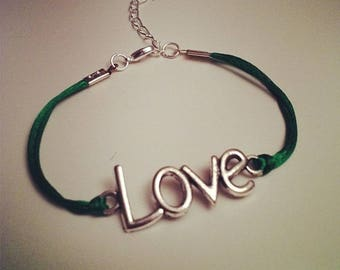 Green cord bracelet with LOVE silver