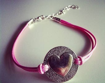 Pink cord bracelet with heart