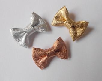 3 hand-made metallic knots of 2 x 3 cm