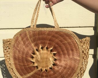 Vintage circular straw beach bag with woven sun pattern 1970s 1980s