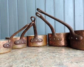 Vintage French 1mm copper graduated cooking pots, sauce pans, cast iron handles, tin lining, vintage french professional pans