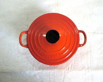 Le Creuset size 18 casserole or Dutch oven in retro orange changing to red at the base