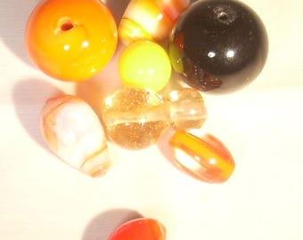 Mixed assortment lampwork orange and black glass bead