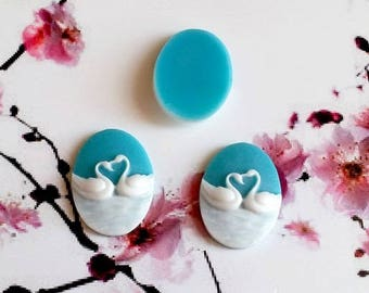 2, 25x18mm cameos, resin, white swans on a hard blue