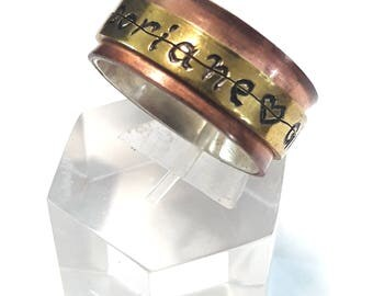 Rotating - spinner - ring with secret code and custom text. Silver ring, copper and brass.
