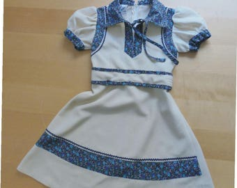 70s girls dress 4-5 years old. Bohemian polyester beige dress with blue floral details, made in Greece. In a very good vintage condition.