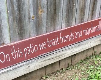 "Handmade, Wooden, Long Sign. ""On this Patio we toast friends and marshmallows"". How warm and welcoming is this?. Family, Friends, Neighbors."