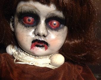 Creepy haunting monster doll