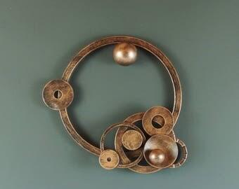 Metal wall art, circle sculpture