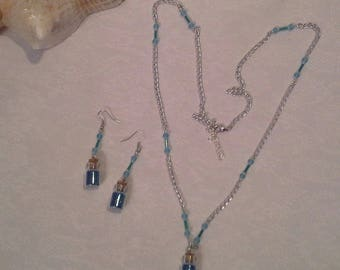 set of necklace and earrings glass vial pendant blue glitter