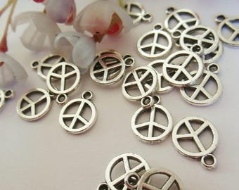 set of 8 charms in silver metal peace sign